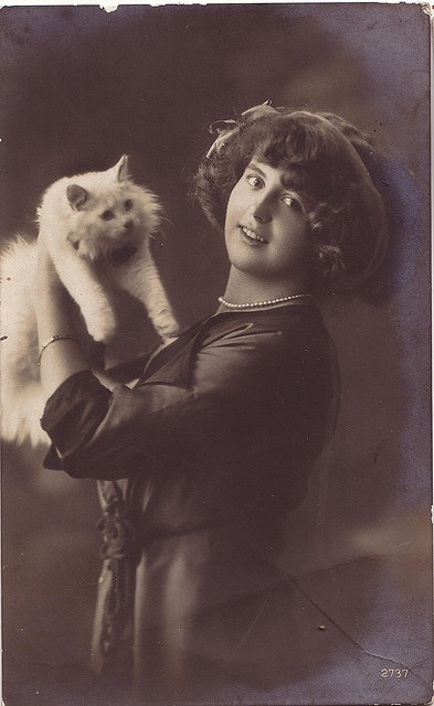 girl with white cat
