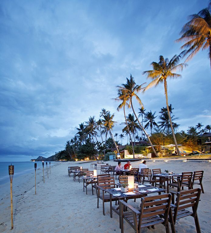 Step out of your Koh Samui villa and enjoy a romantic sunset on the beach
