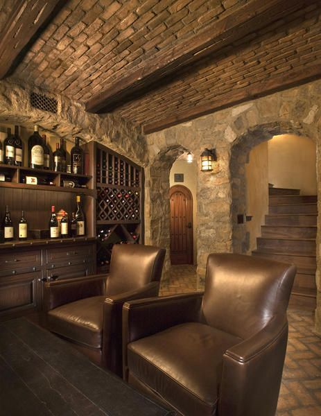 Brick barrel ceiling with beams, and rustic stone walls...