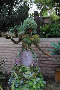 Lady made of wire, succulants, flowers..creative juices at work here.