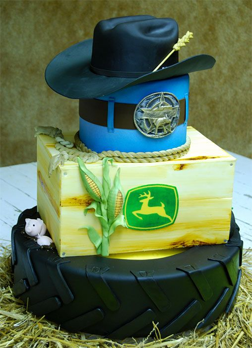 Cowboy - Not your typical High School Graduation Cake.  We got to deliver this one to Seaforth, Minnesota.  Derek was a true Cowboy, John Deere driving, PBR riding, roping, Cowboy!  This city girl was confused at first as to why an eighteen year old's mom would agree to let us replicate his prized PBR belt buckle, then I found out that it doesn't stand for Pabst Blue Ribbon (how embarrassing).  We copied his buckle, in frosting, and topped the cake with his own hat, made out of cake and f