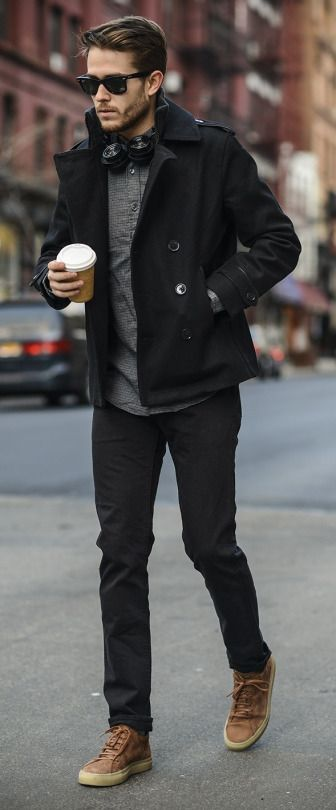 Black peacoat over grey check with black denim and brown sneakers.