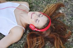 Beautiful woman with headphones outdoors. stock photo