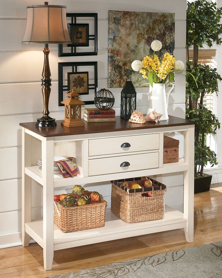 whitesburg buffet server with center drawers and open shelving