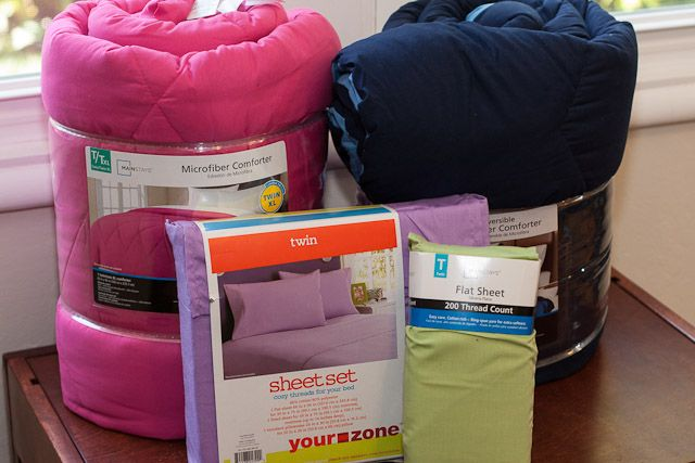 This is a great tutorial for converting inexpensive comforters into end-cap bedding for bunk beds or other tight fit beds.  The bedding at the foot of the bed is fitted for the mattress so there is no bulky tuck-ins, and the spread stays snugly in place - brilliant!