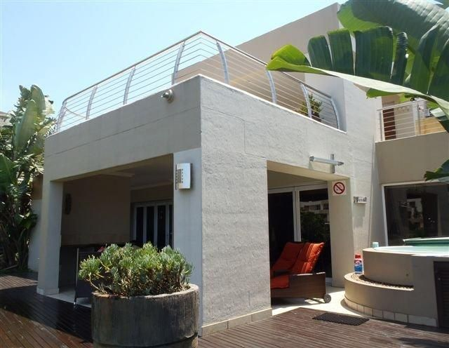 Sabuti 48 in Ballito (Sleeps 8). Safe and secure 4 bedroom ground floor unit with outstanding sea view, swimming pool and Jacuzzi Part of the Simbithi Eco Estate. 18 Hole golf course.   This holiday home in Ballito features a covered patio with hot tub, braai facilities and outdoor seating. #Where2Stay #simbithiecoestate