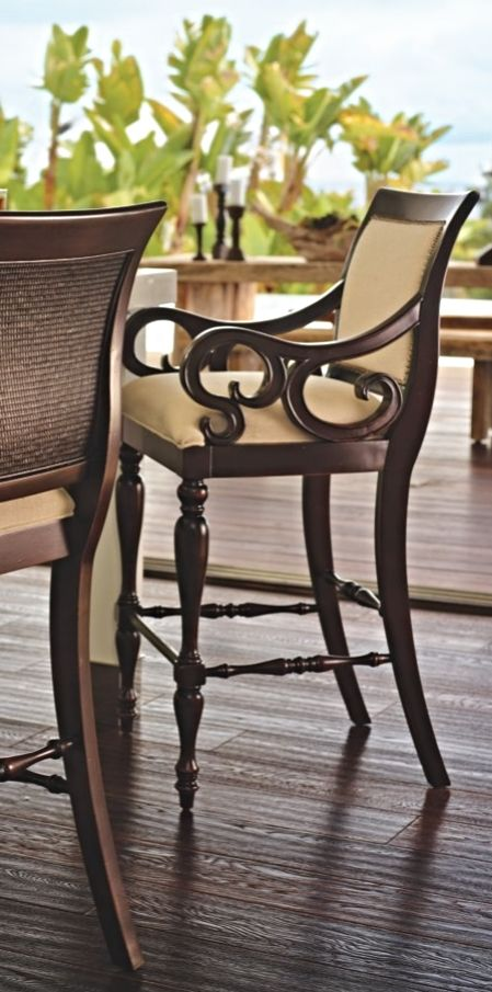 With a mahogany veneer, deep seating, and a woven rattan back, our Montserrat Coastal Barstool exudes the coastal vibe of British Colonial fine furnishings.