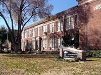 """In 1892, Dallas established its first high school for African Americans. In 1911, the school was  named the Dallas Colored High School. The school was moved in 1922 and renamed Booker T. Washington High School, after the African-American education pioneer Booker T. Washington.In 1939, Wilmer-Hutchins Colored High School of the Wilmer-Hutchins ISD burned down in a fire  Afterwards, African-American WHISD students were sent to DISD high schools for """"colored"""""""