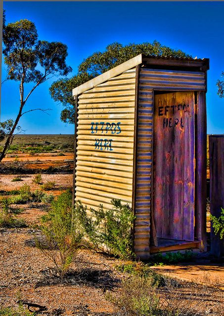 Outback outdoor toilet. Known as an 'outhouse' or 'dunny'. No flushing water in these, of course, just a hole in the ground with a crude wooden seat above. We had one when I was growing up in outback NSW.