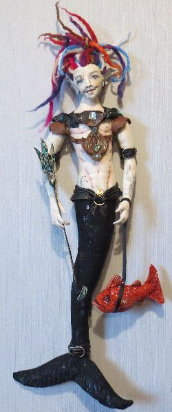 "REIF - Guardian Of The Deep  27"" Wall Merman Doll Pattern  by Sharon Mitchell Guardian of sea creatures, and general RMM - Reef Maintenance Merman!  Reif is often seen working with Greenpeace, during clashes on the high seas! Currently organizing shoals of fighting fish, using his guard-fish Snapper, to repel and disrupt underwater blasting in NZ waters and create general mayhem to protect the undersea environment!  As a 27"" wall doll.  Cloth Doll Patterns and Tutorials by  Sharon Mitchell"