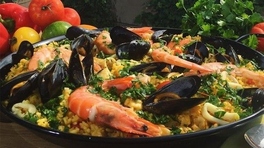 If your half term has been spent on a staycation and you've not managed to escape the ups and downs of this week's weather, then never fear because Phil Vickery's on hand to brighten your Friday evening by transporting the sun-drenched delights of the Mediterranean into your very own kitchen with his super simple paella! What does it taste like? Like sunshine!