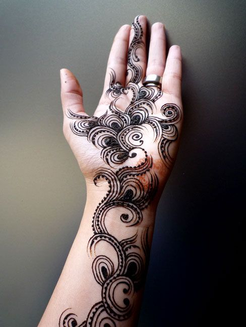 lovely and unique mendhi hand - but is that black henna? No way!