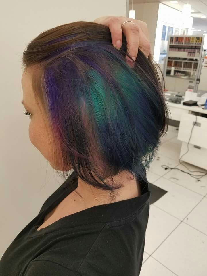 This picture doesn't do my hair justice!! Peekaboo colors... Oil Slick/Peacock colors.  At first glance, you see my natural hair color... When my hair moves by the wind or I move it, you'll see flashes of jewel tone colors! It's so pretty and fun! I've gotten so many compliments on my hair, even from complete strangers!