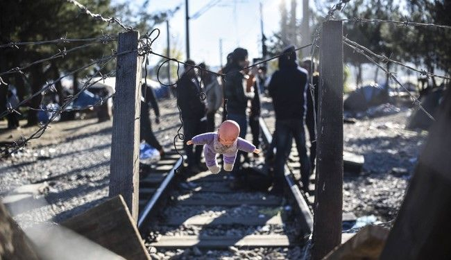 Frustrated migrants and refugees block a railway train from heading into Greece in protest over being barred entry to Macedonia, as aid workers warn over conditions at the border.