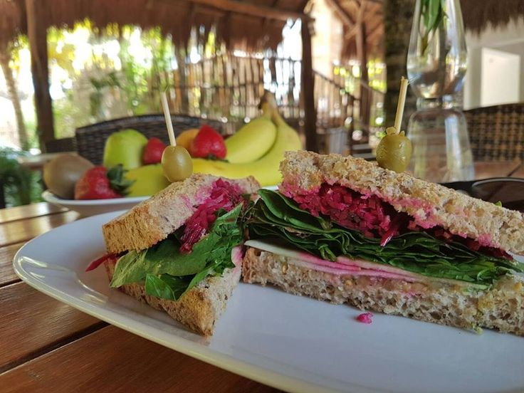 Veggie Sandwich:   avocado + spinach + roasted eggplant + apple + pickled beetroot + dijon mustard. With our homemade bread.