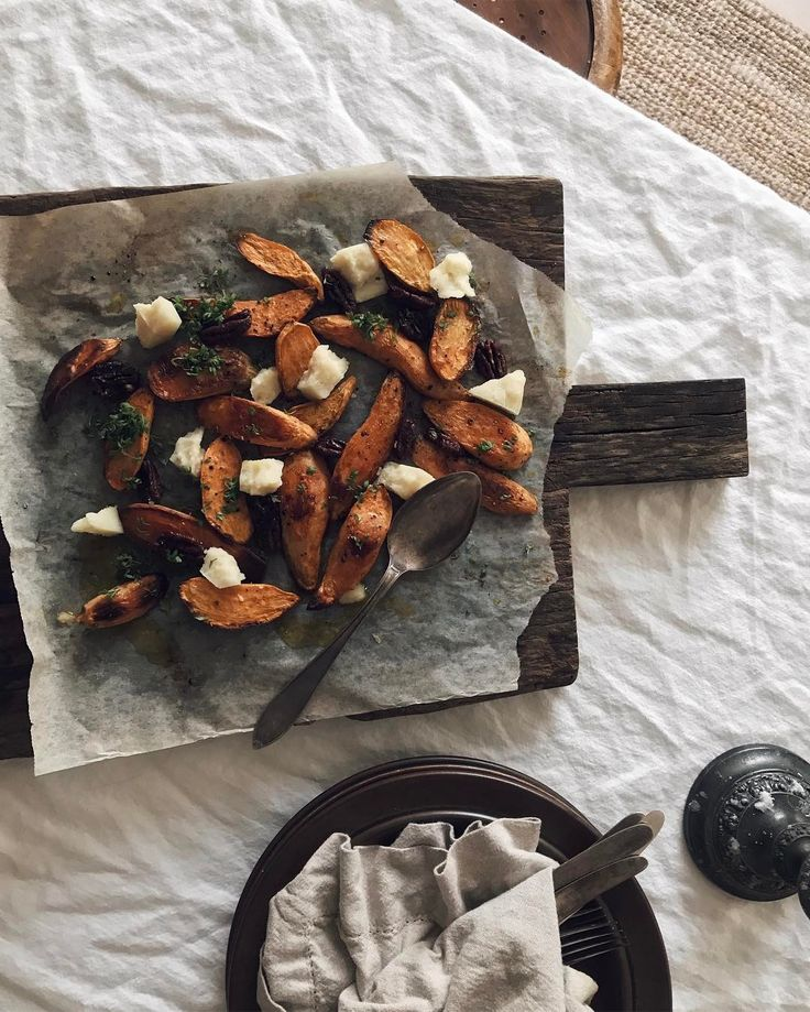 Sweet potatoes with candied pecans, chunks of pecorino and cress