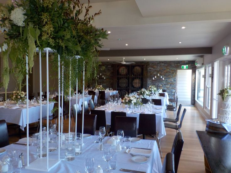 Sky high tall centrepieces with falling greenery.
