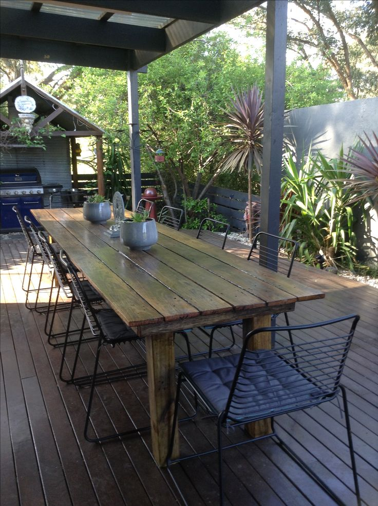 Homemade outdoor dining table. Chairs and cushions from