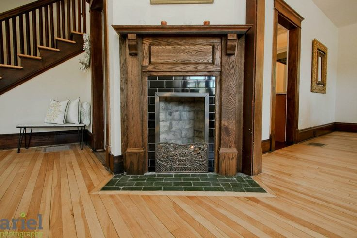 Nicole Curtis Rehab Addict -Dollar House-    Living Room AFTER #Ariel Photography #fireplace #woodwork