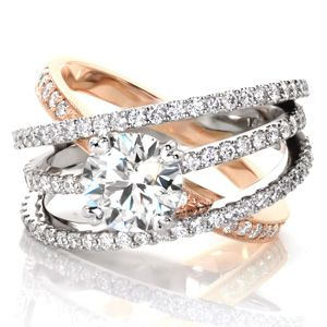 Design 3296- Our collection of split shank engagement rings feature unique designs that draw attention towards the center stone. Each ring is custom made around your center stone and finger size.  http://www.knoxjewelers.biz/products/design-3296