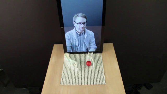 "You have to see it to believe it! -- ""inFORM is a Dynamic Shape Display that can render 3D content physically, so users can interact with digital information in a tangible way. inFORM can also interact with the physical world around it, for example moving objects on [its] surface."""