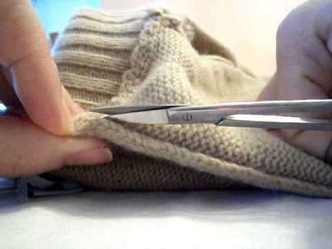 Video Tutorial: how to cut a sweater seam to unravel it.