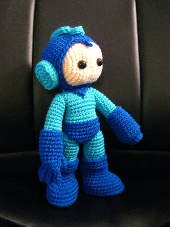 The crochet megaman pattern shown here is sold on Etsy by ...