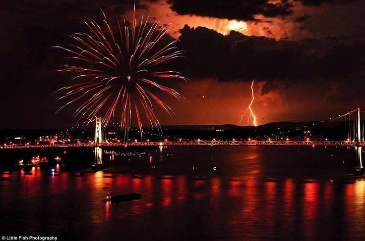 Heart-stopping image: Michael Pescetti captured the lightning bolt while watching the annual fireworks display on a pedestrian walkway overlooking the Hudson River in Poughkeepsie, New York