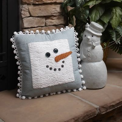 """Snowman Pillow  Project by Kristine Peterson.  17"""" x 17""""    Make this cute and cozy flannel pillow for a quick gift—or for yourself. Use pom-pom """"snowball"""" trim for fun."""