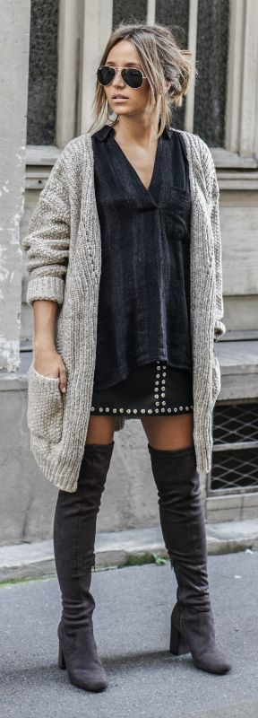Camille Callen wears over the knee boots with a knitted boyfriend cardigan and a studded leather mini skirt.   Blouse: River Island, Skirt: R.I, Jacket: My Parisian Style.