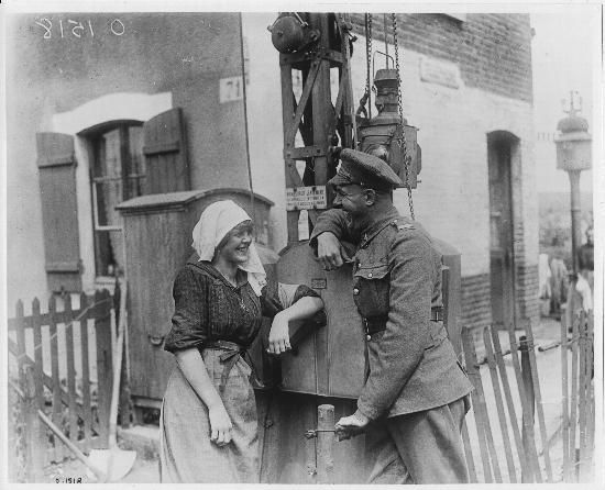 Yvonne, the gatewoman of a railway crossing located just behind the Canadian lines. June 1917.