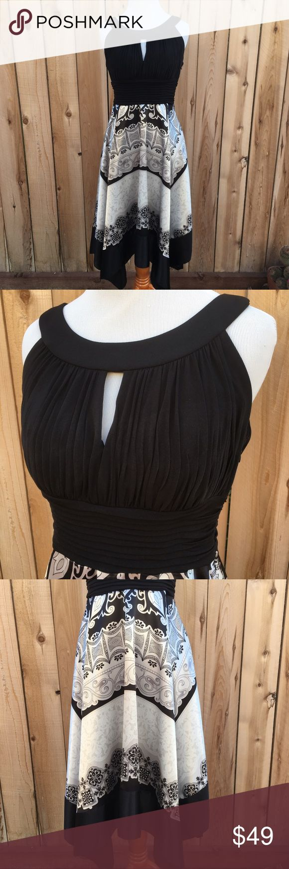"""🆕 Black & White Scarf Dress Rounded neck with a scarf style skirt. Worn once to a wedding. Colors are black, white & gray. Skirt of dress is 100% Polyester, top solid black part of dress is a stretchy 95% Polyester & 5% Spandex. Side zipper with clasp. Also two buttons in back at neckline. Top is lined with bra pads so can go braless. Measurements are 17"""" pit to pit, 12.5"""" relaxed to 16"""" stretched waist and 36"""" long in center to 46"""" longest point to bottom of dress. In excellent like new…"""