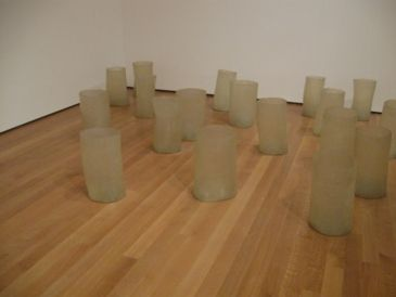 "Eva Hesse - Repetition 19, III, 1968, fiberglass and polyester resin, 19 units each 19 to 20 1/4"" (48 to 51 cm) x 11 to 12 3/4"" (27.8 to 32.2 cm) in diameter, Museum of Modern Art, New York"