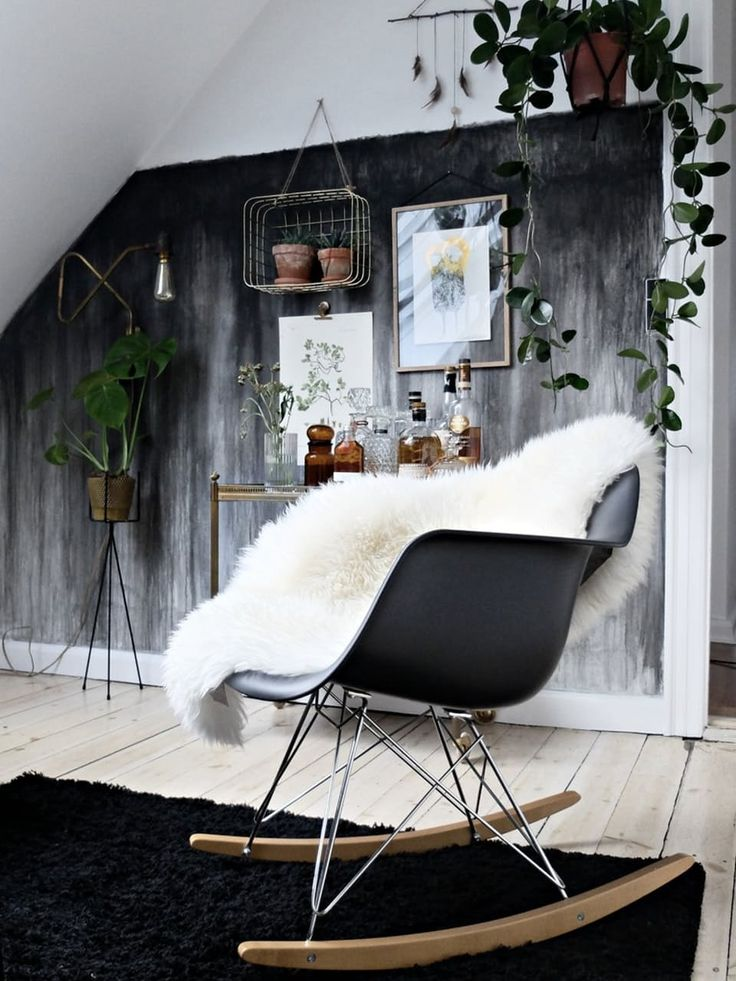 A rocking chair with a lambskin sets the tone for coziness.