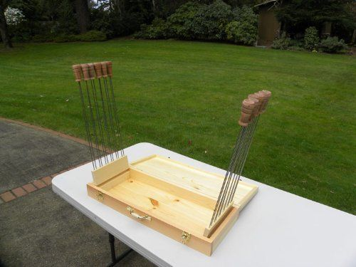 """Super Skewer Hand-crafted Wooden Case with 12 Original Super Skewers - FREE STANDARD SHIPPING IN USA by Super Skewer. $189.95. Hand-Crafted, custom-made case for Super Skewers. Made in the USA. Non-stick, Stainless Steel Tines. Double 19"""" Prongs - Food will not rotate. Wooden Handles - No hot pads needed. This is a great gift for the Barbequer that has everything. This case is custom made exclusively for Grill Time and, as are all our products, it is made in the USA. The case is ..."""