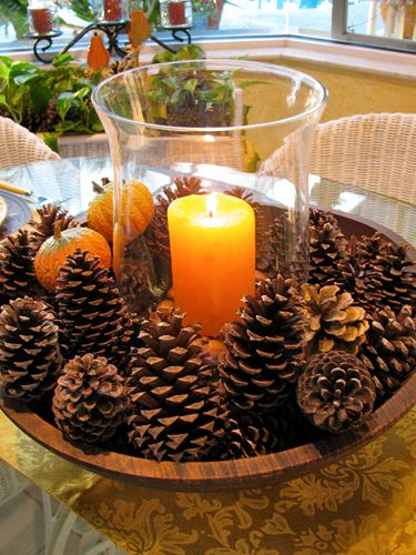 dough bowl - glass hurricane in center with candle - add acorns or other nuts around candle inside hurricane - pinecones and pumpkins