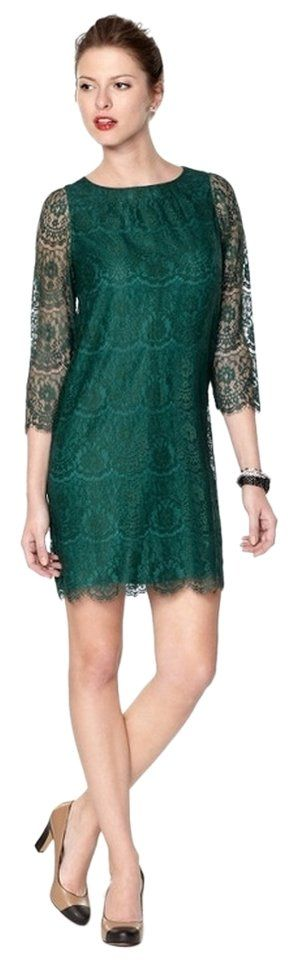 Fossil Lace Elegant Dress. Free shipping and guaranteed authenticity on Fossil Lace Elegant Dress at Tradesy. Classy and elegant emerald green lace dress...