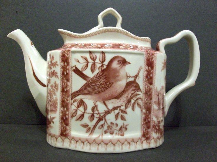 Antiche riproduzioni red tea pot with song bird design for Riproduzioni design