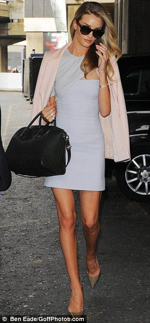 #workwear #streetstyle | Rosie Huntington-Whitely in a pastel outfit featuring a powder pink coat over a dove-grey Marios Schwab fitted dress styled with nude pumps & a dark green Givenchy handbag