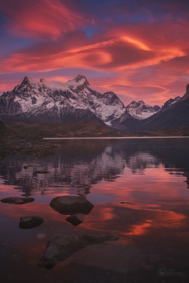 """Yuri Beletsky caught this twilight photo on June 5, 2017. He wrote: """"We were absolutely thrilled to witness truly amazing burst of colors over the mountains in Torres del Paine national park in Chilean Patagonia. The colorful moment lasted just few minutes, but it was quite spectacular indeed. At some point we had a feeling that the whole scene was flooded with soft red glow coming from the sky. I hope you'll enjoy the view!"""" ~ EarthSky News"""