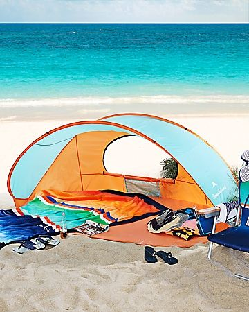 Solace from the sun is a snap with this portable pop-up shelter. Compact and easy to set up (no assembly required!), it's made from lightweight polyester with mesh windows for optimum ventilation. Ideal for the beach, park or yard, this open-front day tent protects against the sun and wind. Metal stakes and tie-down cords keep it securely anchored. Lightweight polyester shell; wire frame; metal stakes with tie-down cords. Ships separately via FedEx Ground; gift wrap not available. Imported…