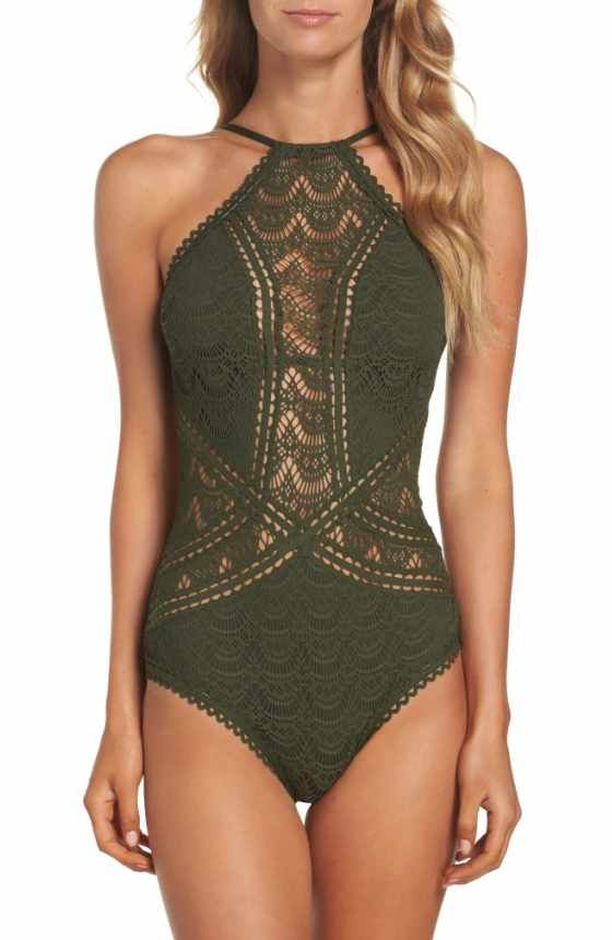 Free shipping and returns on Becca Mardi Gras One-Piece Swimsuit at Nordstrom.com. The simple front and shelf bra make this swimsuit flattering and comfortable, but the one-shoulder design and strappy back has a fashion-forward feel. Crocheted trim and tassels add vibrant pops of color to the contemporary one-piece.