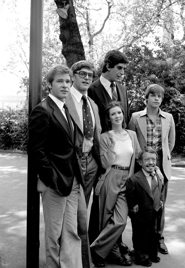 Star Wars original cast members from 1977 Left to right: Harrisin Ford was Han Solo; David Prowse (voice was James Earl Jones) was Darth Vader; Peter Mayhew was Chewbacca; Carrier Fisher was Princess Leia; Mark Hamill was Luke Skywalker and Kenny Baker was R2D2