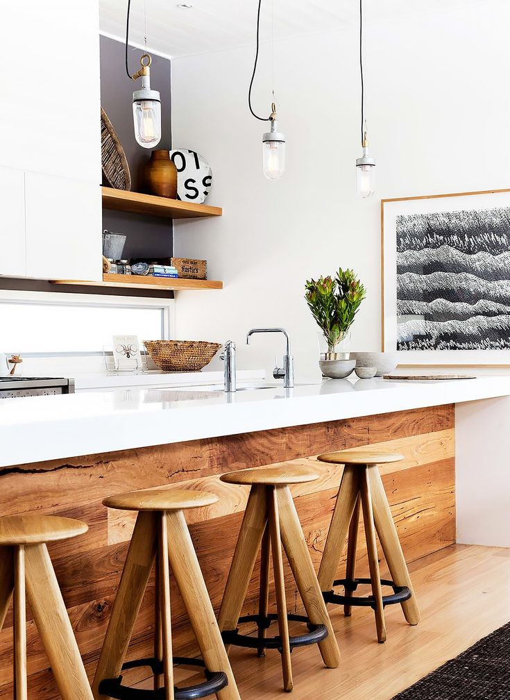 This Australian Home Proves Beachy Can Be Chic via @MyDomaine I like the dark grey wall and wood shelves                                                                                                                                                     More