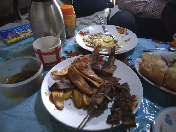 Plantain, eggs, suya, fried fish and bread for breakfast in Cameroon