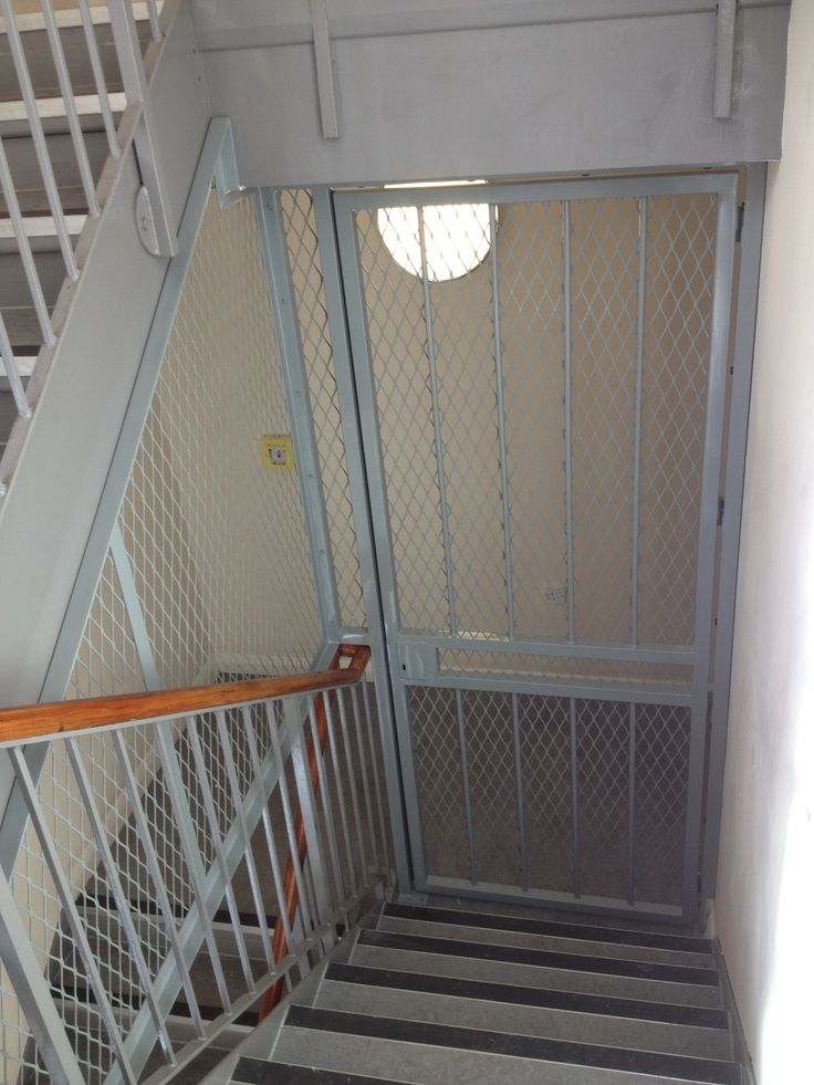 rsg3000 security door gate together with rsg800 mesh grills fitted to the staircase of residential building