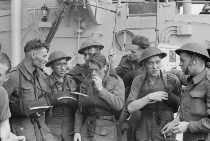 "THE ROYAL NAVY DURING THE SECOND WORLD WAR: THE DIEPPE RAID, AUGUST 1942  part of ""ADMIRALTY OFFICIAL COLLECTION"" (photographs) Made by: Pelman, L (Lt)  Some of the Canadian troops resting on board a destroyer after the Combined Operations daylight raid on Dieppe. The strain of the operation can be seen on their faces."