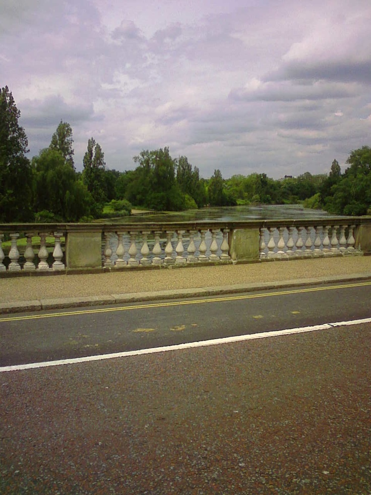 The Serpentine from the bridge that runs between Hyde Park and Kensington Gardens. At the far end of the lake is the Princess Diana Fountain.