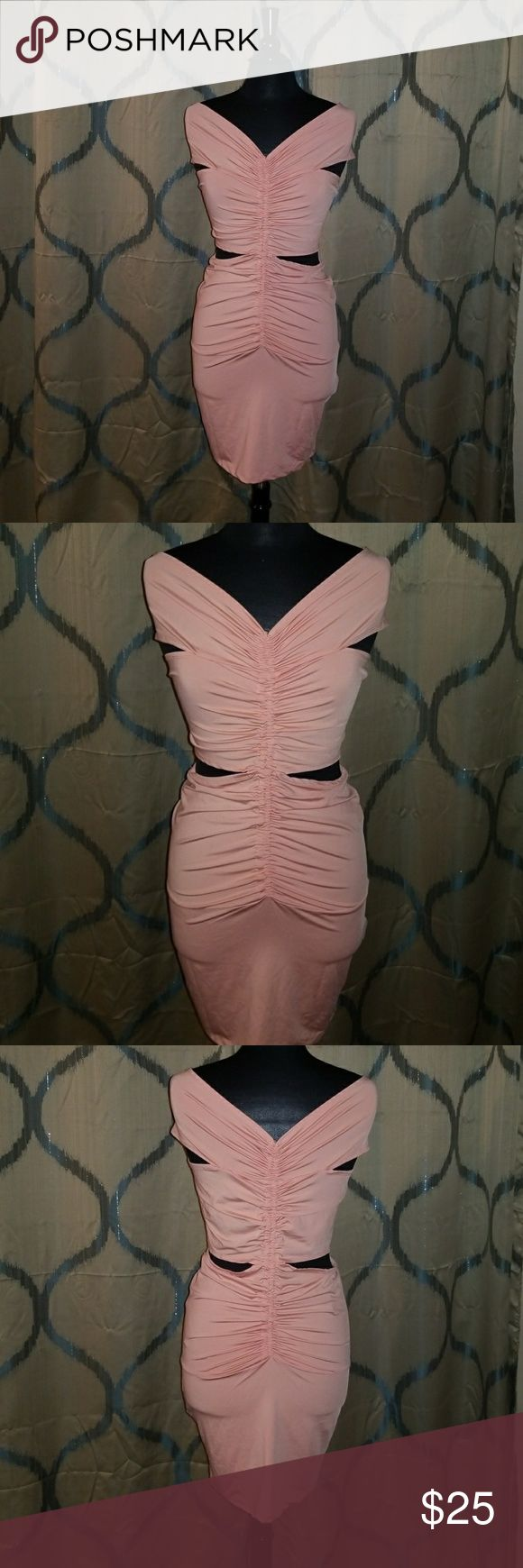 Party Dress NWOT peach party dress. Has cutouts on the sides. Never worn, excellent condition. Very stretchy. 92% polyester, 8% spandex Dresses Mini