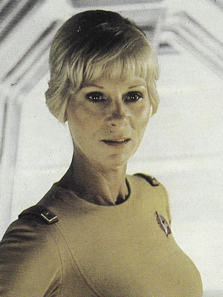 Lieutenant Janice Rand (character named after Ayn Rand, the philosopher) played by actress, Grace Lee Whitney.  She appeared on TOS of STAR TREK and in TMP, ST III, ST IV, and in ST VI as Communications Officer and Third in Command under Captain Sulu of The EXCELSIOR.  After the death of Commander Beltran, she became the ship's First Officer.